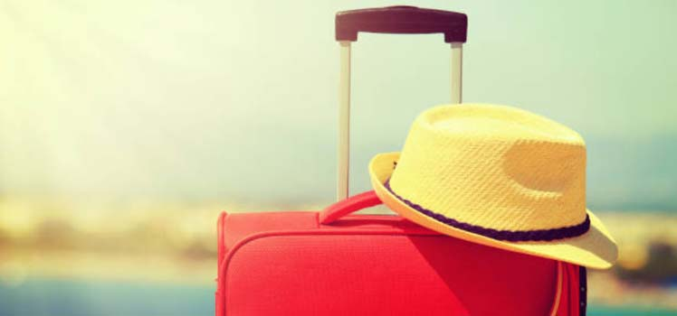 suitcase and sunhat